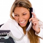 """Photo credit: """"Portrait Of Smiling Businesswoman Busy On Phone"""", by imagerymajestic"""