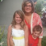 Linda with her children. This was graduation day for Linda's house last June (5th grade and Kindergarten)